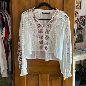 a long sleeve sheer white flowered blouse